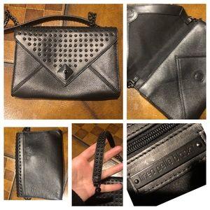Linea Pelle grommet dress bag black